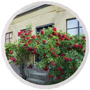 Roses Growing Near The House In A Swedish Town Visby Round Beach Towel