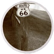 Round Beach Towel featuring the photograph Route 66 Shield And Fence Sepia Post by Frank Romeo