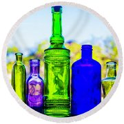 Row Of Colored Bottles Round Beach Towel