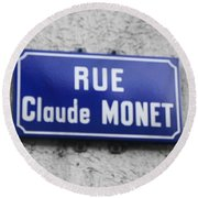 Round Beach Towel featuring the photograph Rue Claude Monet by Therese Alcorn
