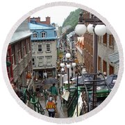 Round Beach Towel featuring the photograph rue du Petit Champlain by John Schneider