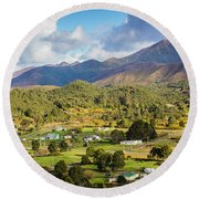 Rural Landscape With Mountains And Valley Village Round Beach Towel