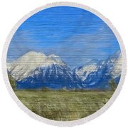 Rustic Grand Teton Range On Wood Round Beach Towel by Dan Sproul