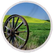 Rustic Wagon Wheel In The Palouse Round Beach Towel by James Hammond