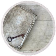 Round Beach Towel featuring the photograph Rusty Key On The Old Tattered Book by Michal Boubin