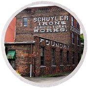 Round Beach Towel featuring the photograph Schuyler Iron Building by Trina Ansel