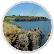 Seascape Dunmore East. Round Beach Towel