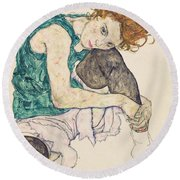 Seated Woman With Bent Knee Round Beach Towel