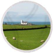 Round Beach Towel featuring the photograph Sheep Grazing On Irish Coastline by Juli Scalzi