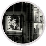 Round Beach Towel featuring the photograph Shopkeeper At Night by John Williams