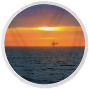 Silhouetted Oil Drilling Platform  Round Beach Towel by Allan Levin
