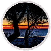 Silhouettes Over Blue Water Round Beach Towel