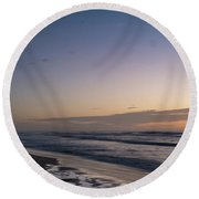 Single Man Walking On Beach With Sunset In The Background Round Beach Towel