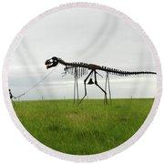 Skeletal Man Walking His Dinosaur Statue Round Beach Towel