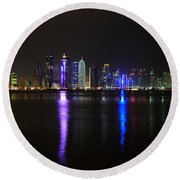 Skyline Of Doha, Qatar At Night Round Beach Towel