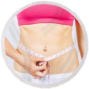 Slimming Woman Holding Tape Measure To Stomach Round Beach Towel