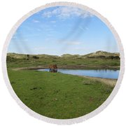 Small Lake With Wild Horses Round Beach Towel