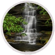 Small Waterfalls In The Forest. Round Beach Towel