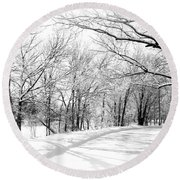 Snow Covered River Road Round Beach Towel