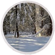 Snow Falling Off Cedars Round Beach Towel
