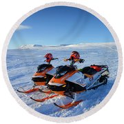 Round Beach Towel featuring the photograph Snowmobiles In Iceland In Winter by Matthias Hauser