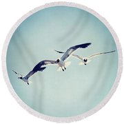 Round Beach Towel featuring the photograph Soaring Seagulls by Trish Mistric