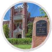 Spirit Of Learning Statue At The University Of Oklahoma  Round Beach Towel