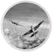 Round Beach Towel featuring the photograph Spitfire Attacking Heinkel Bomber Black And White Version by Gary Eason