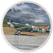 Round Beach Towel featuring the photograph Spitfire Under Storm Clouds by Paul Gulliver