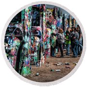 Round Beach Towel featuring the photograph Spray Paint Fun At Cadillac Ranch by Randall Nyhof