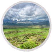 Spring Storm Moving Over The Bradshaw Round Beach Towel by Charles Ables