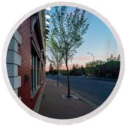 Round Beach Towel featuring the photograph St. Anne Street At Dusk by Darcy Michaelchuk