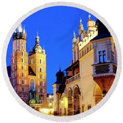 Round Beach Towel featuring the photograph St. Mary's Basilica And Cloth Hall by Fabrizio Troiani