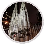 St Patrick Cathedral At Night Round Beach Towel by John McGraw