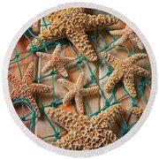 Starfish In Net Round Beach Towel