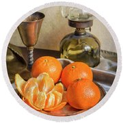 Round Beach Towel featuring the photograph Still Life With Oil Lamp And Fresh Tangerines by Jaroslaw Blaminsky