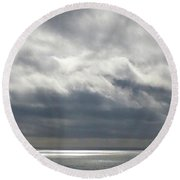 Storm Clouds On The Horizon Round Beach Towel