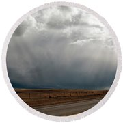 Storm On Route 287 N Of Ennis Mt Round Beach Towel