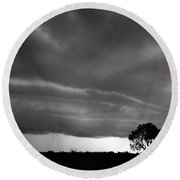 Round Beach Towel featuring the photograph Storm Passing Over Solitary Tree In The Desert by Keiran Lusk