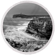 Round Beach Towel featuring the photograph stormy sea - Slow waves in a rocky coast black and white photo by pedro cardona by Pedro Cardona