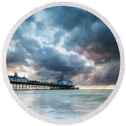 Stormy Sunrise Over Eastbourne Pier Round Beach Towel