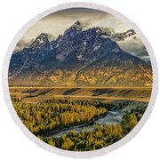 Stormy Sunrise Over The Grand Tetons And Snake River Round Beach Towel