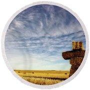 Strawman On The Prairies Round Beach Towel