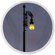 Round Beach Towel featuring the photograph Street Lamp Shining At Dusk by Michal Boubin