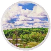 Striking Clouds Above Small Water Inlet And Green Trees Round Beach Towel
