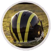 Striped Wolverine Helmet On The Field At Dawn Round Beach Towel