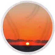 Sun Balancing On The Horizon Round Beach Towel