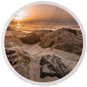Sun Coming Over The Rocks  Round Beach Towel