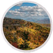 Sun Dappled Mountains Round Beach Towel