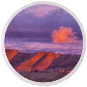 Sunlit Hills And Clouds Round Beach Towel